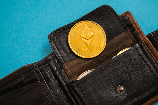 Gold coin with ethereum symbol.