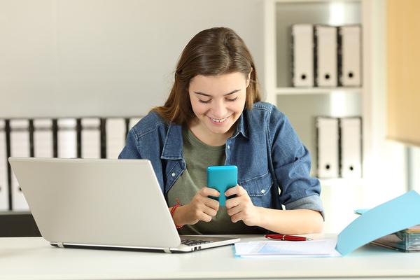 Teenager using her smartphone.