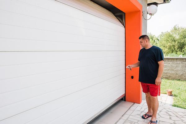 Man opening garage door