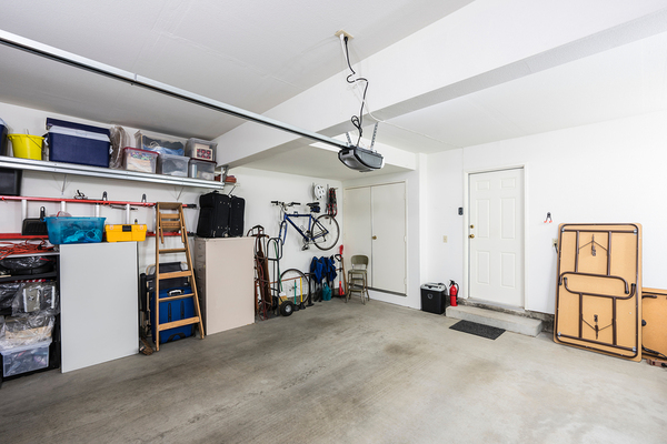 Neat organized garage with household items.