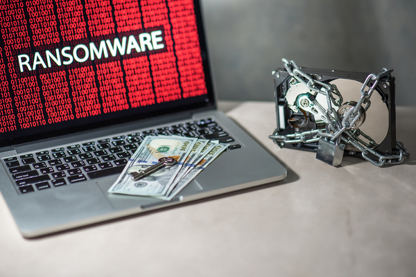Ransomware word displayed on a laptop.