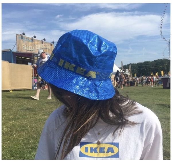Person wearing an Ikea hat and t shirt.