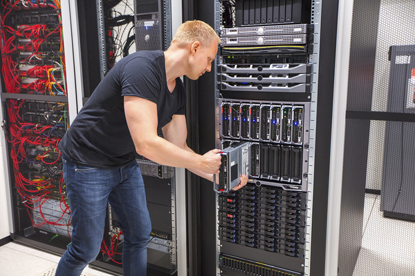 Computer technician working on a server.