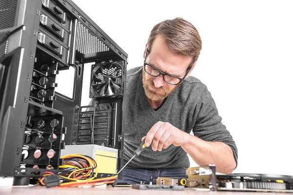 Computer technician working on a desktop computer.