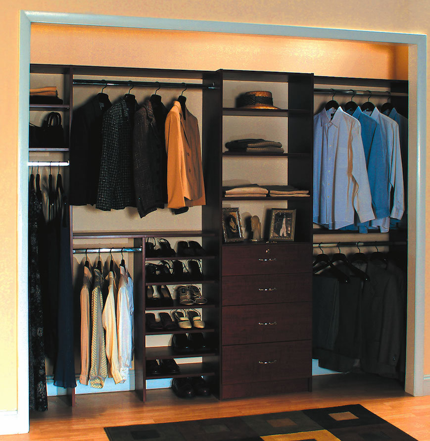 Mens closet organized with shoe shelves, hangers and drawers