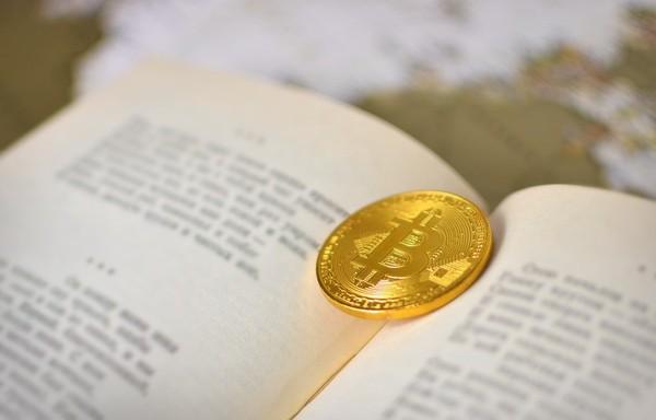 Blockchain book with a gold bitcoin coin.