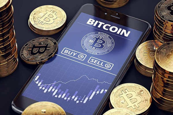 Bitcoin app displayed on a mobile phone.