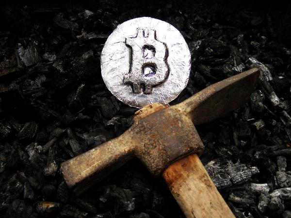 Bitcoin silver coin with pick axe.