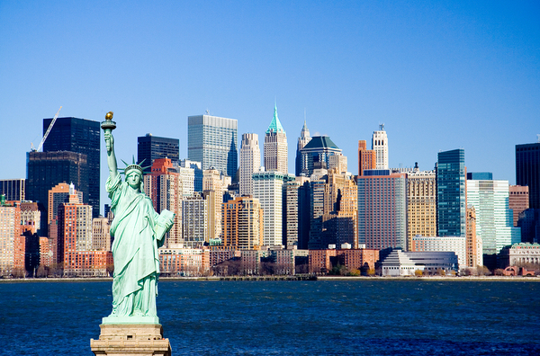 New York City skyline with statue of liberty.