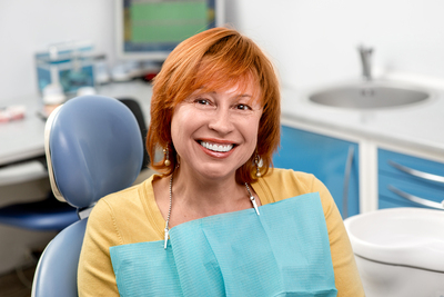 Woman at dentist office with a smile