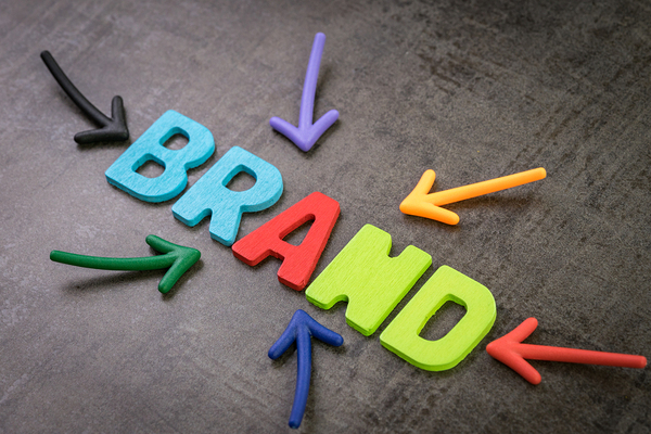 The word brand with colored letters.
