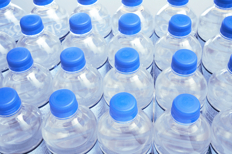 Drink bottled water that has added fluoride.