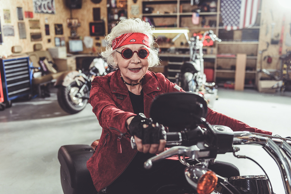 Older lady on a motorcycle in garage