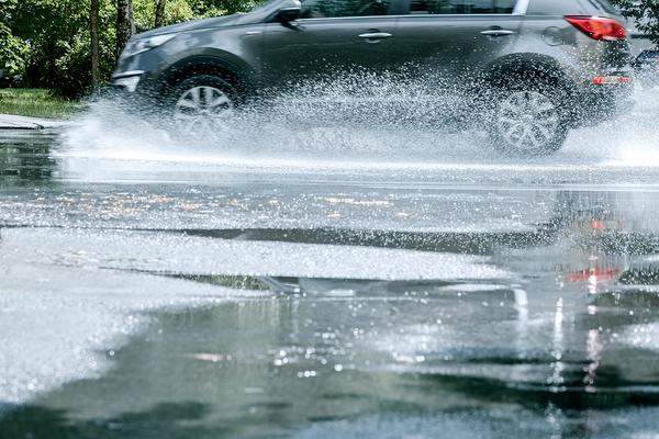 Car driving through a puddle