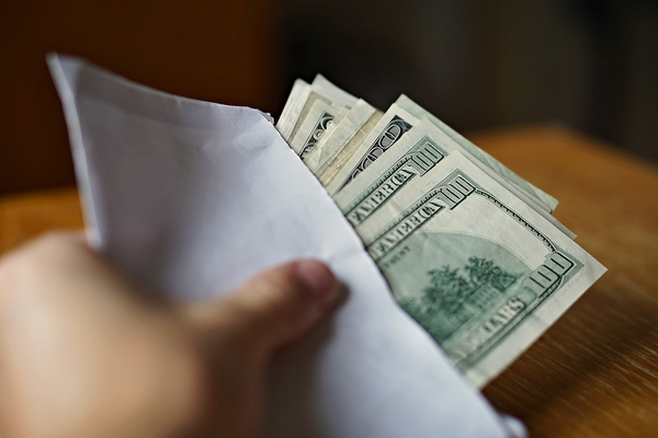Envelope with money.