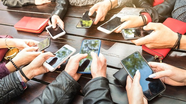 Group holding their phones.