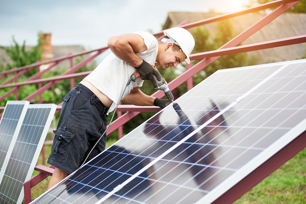 Mani installing solar panels.