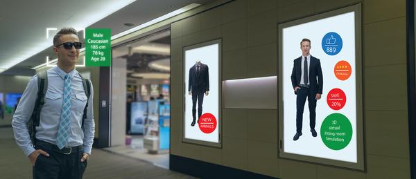 Man walking through a mall.
