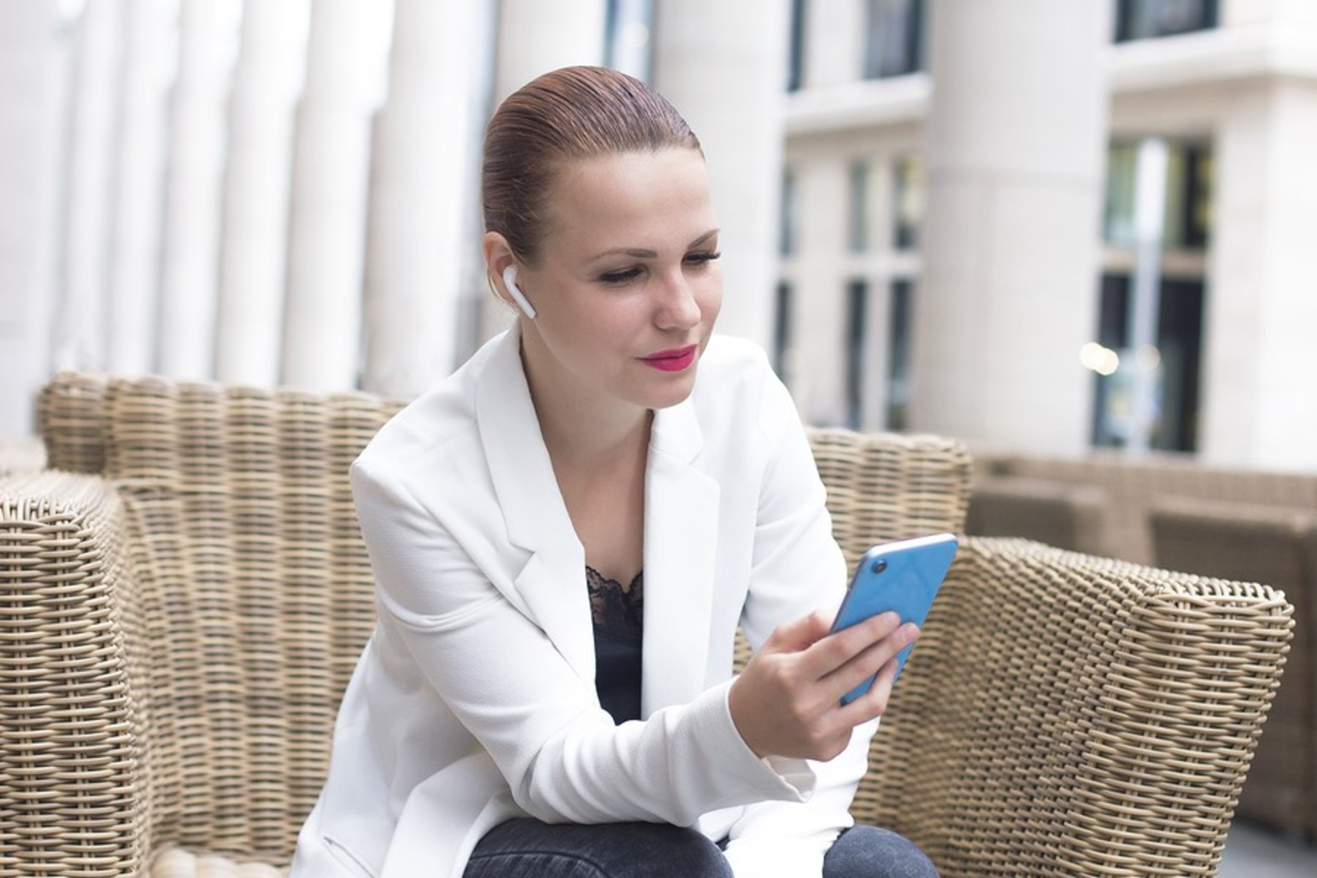 Woman looking intently at her phone.