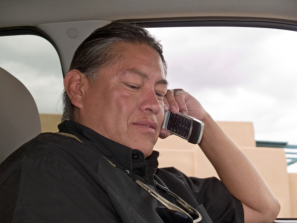 Native American man on his cell phone