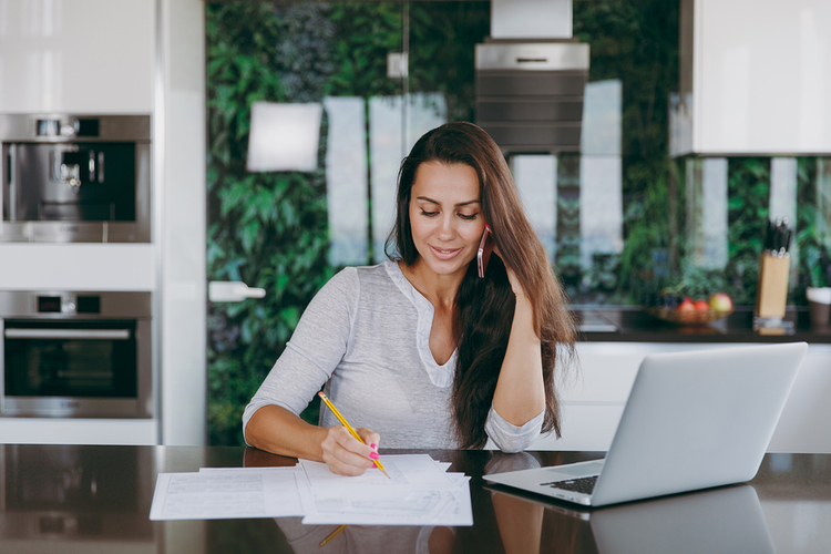 Woman writing notes on paper.