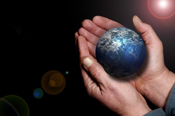 Hand holding a globe.