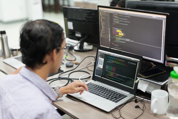 Man working on a desktop computer.