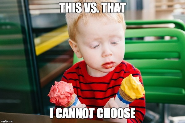 Child holding two ice cream cones trying to decide which one to eat.