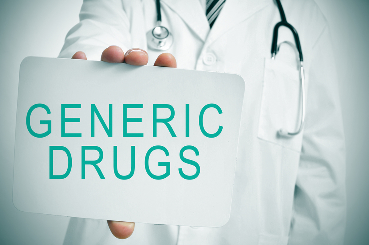 Medical doctor holding a sign labeled generic drugs.