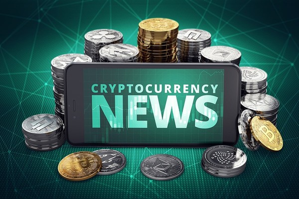 Mobile phone with Cryptocurrency News displayed.