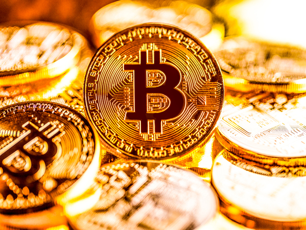 Gold coins with the bitcoin symbol.