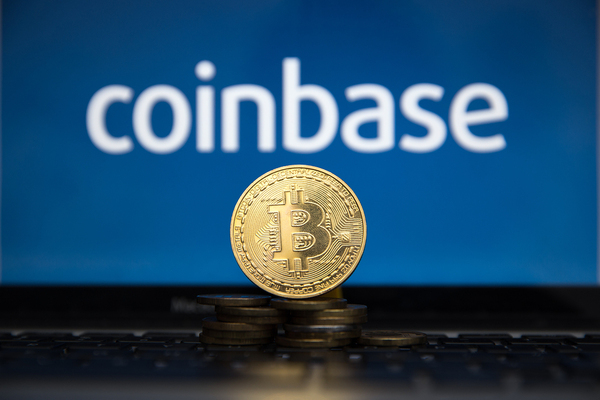 Coinbase and gold coin with bitcoin symbol.