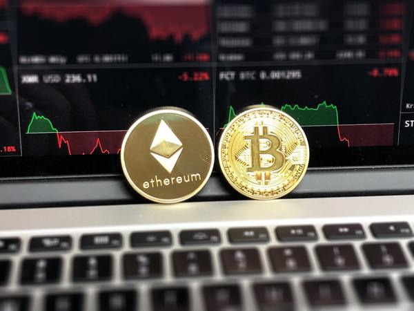 Gold ethereum coin and bitcoin gold coin.