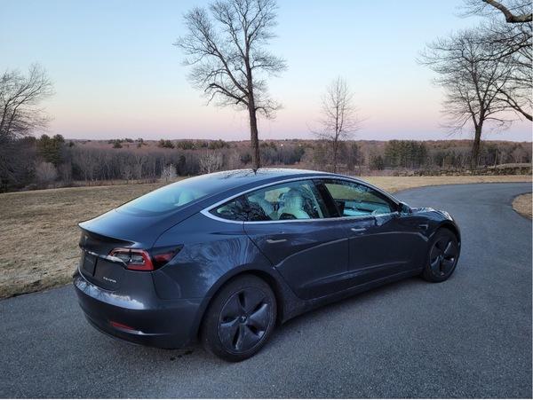 Tesla in a driveway.