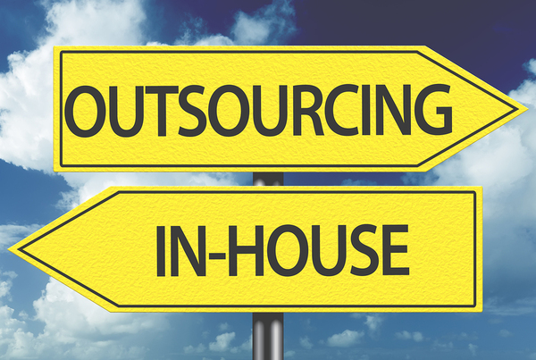 A yellow colored sign that reads outsourcing