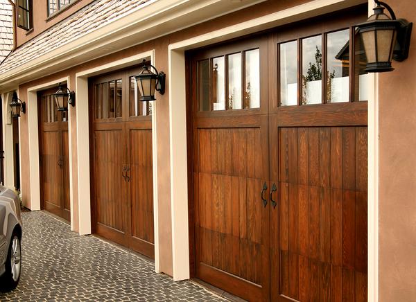 Three car garage with wood doors.