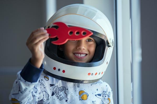 Child wearing a space helmet.