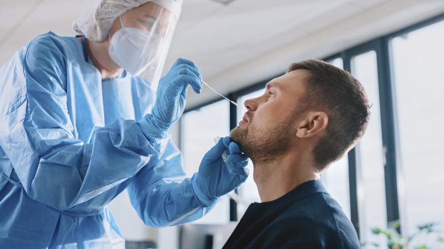 Man getting a COVID-19 test.