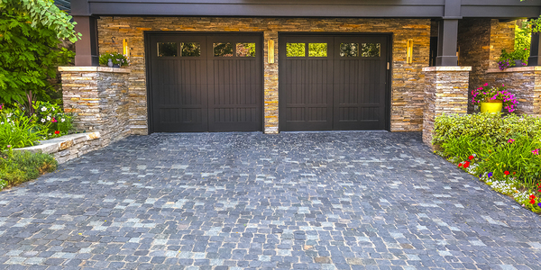 Two car garage with brown doors.