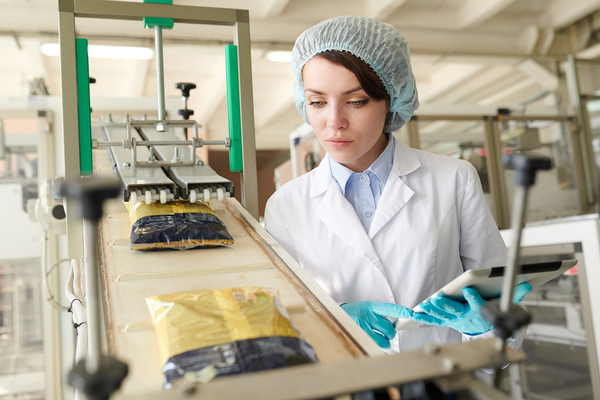Woman working in a food production plant.