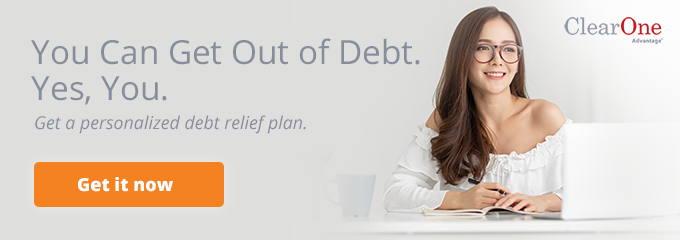 Woman looking at debt relief plan on laptop